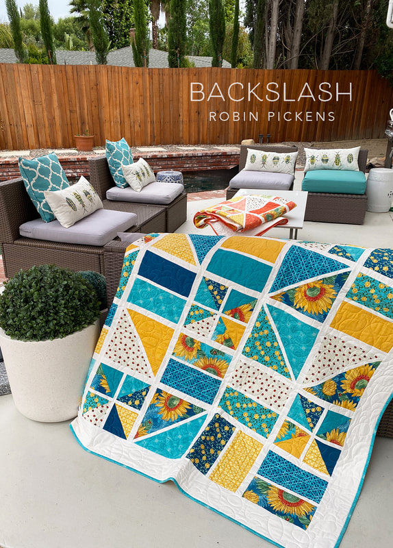 Backslash Quilt on patio using Solana by Robin Pickens