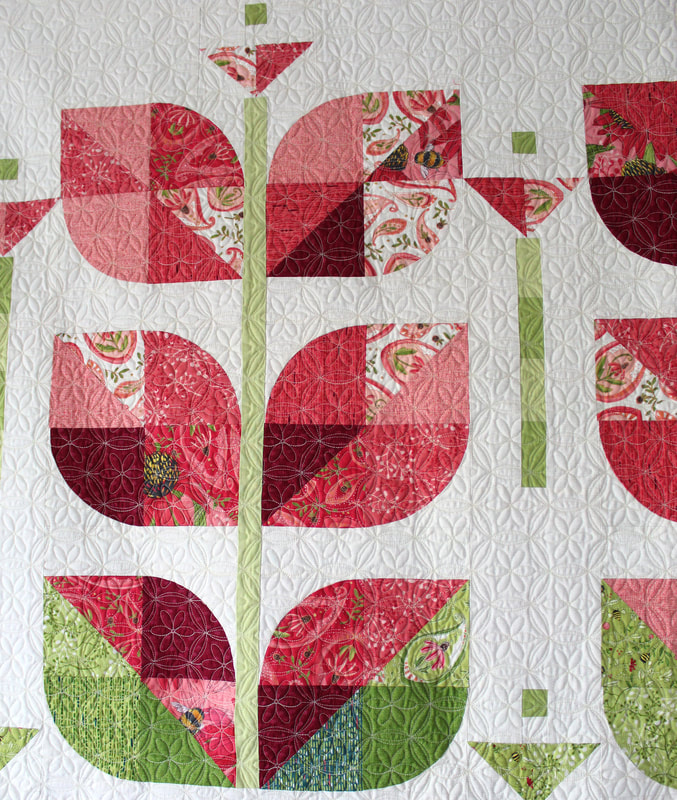 Beanstalk quilt by Robin Pickens in Painted Meadow fabric from Moda Fabrics, Sand dollar pantograph