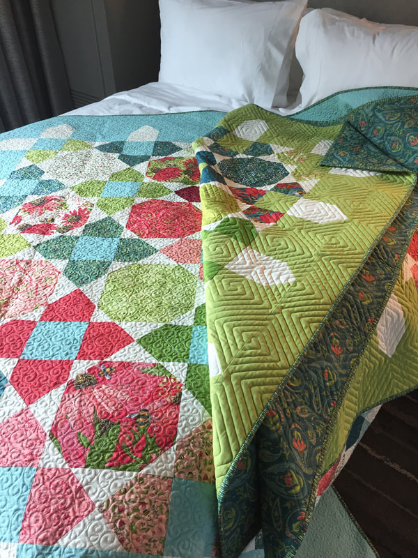 Picket quilt by Robin Pickens with Painted Meadow for Moda Fabrics- on bed