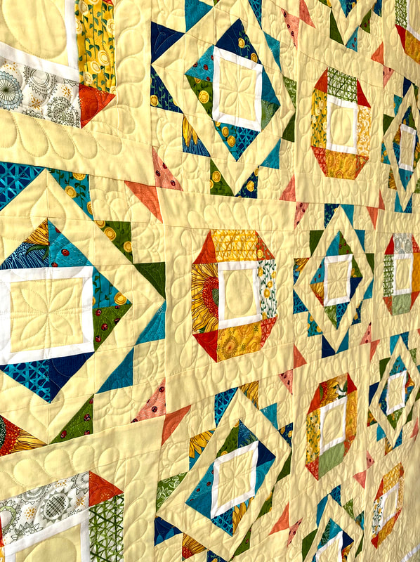 Fair and Square quilting for Solana by Robin Pickens
