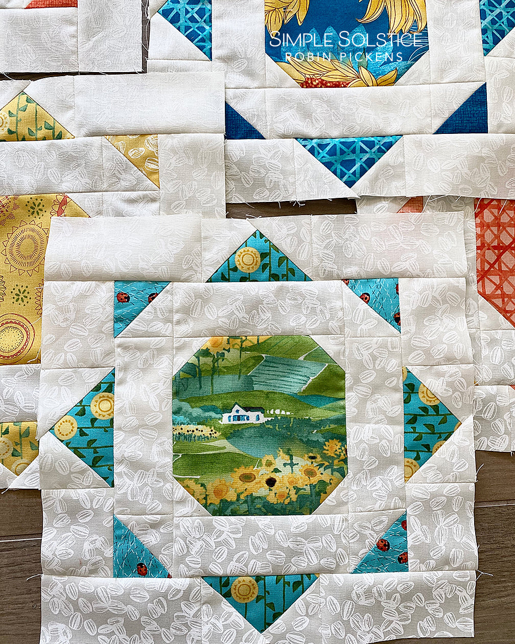 Simple Solstice quilt blocks use HST, flying geese and stitch and flip.