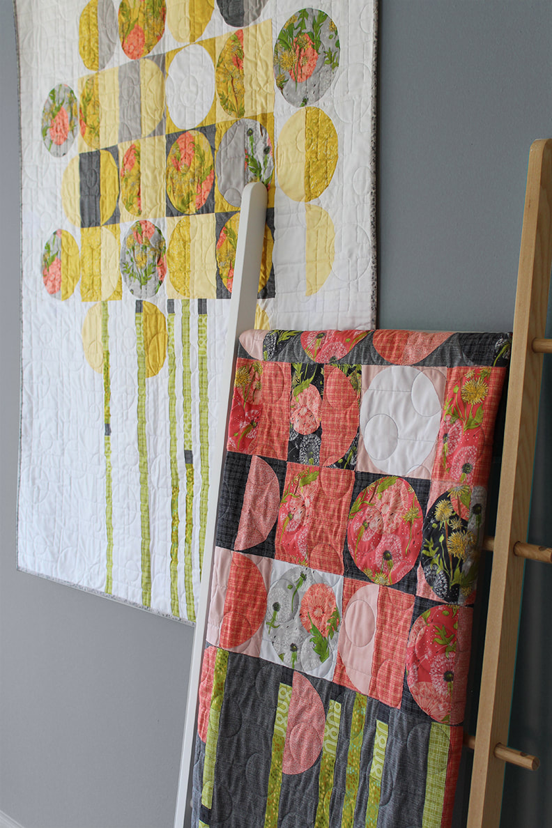 Towards the Sun quilts by Robin Pickens in two colorways