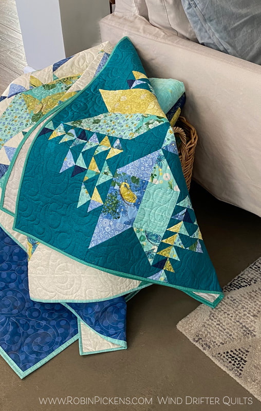 Wind Drifter quilts in basket in Cottage Bleu